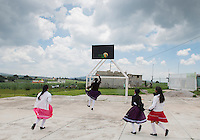 Girls play during break time at the Secondary school Justo Sierra in the  Mazahua indigenous community of San Antonio la Cienega, San Felipe del Progreso, in the Estado de mexico, Mexico