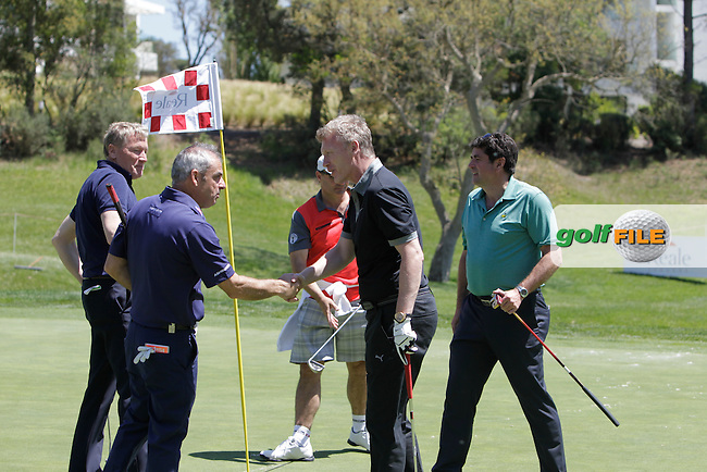 Paul McGinley (IRL) and David Moyes (Am) on the 18th green during the Pro-Am in The Open De Espana at The PGA Catalunya Resort on Wednesday 14th May 2014.<br /> Picture:  Thos Caffrey / www.golffile.ie
