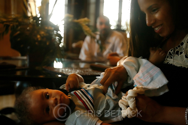 """Miami, FL --12/23/07--.CeCe Boozer holds her son Cameron in their home in Miami. """"It has been a long road,"""" CeCe says. """"Being home alone wasn't easy.and as long as the next appointments go good we'll all be together..At least now we're hopeful. The nights are hard, because when the.kids go to sleep, that is when you feel very lonely.""""..*******************.We are spending Christmas with the Boozer family. Carlos' youngest son, Carmani, recently underwent a bone marrow transplant to help with his sickle cell disease..Photo by Chris Detrick/The Salt Lake Tribune.frame #_1CD5892."""