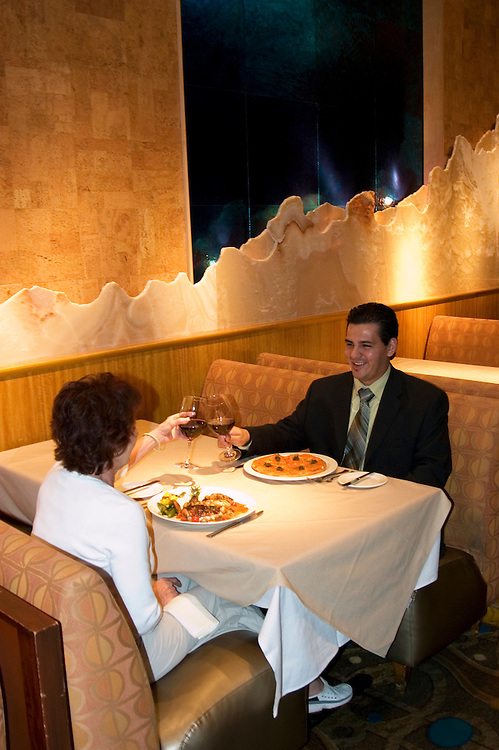 Couple at a restaurant in Las Vegas, Nevada, NV, city, food, drink, wine, couple, man, woman, restaurant, model released, Wolfgang Puck's Spago Cafe in the Forum Shopping Mall of Caesars Palace Hotel and Casino,  property released, Chef's special Salmon Pizza with capers, Cuban Sandwich, Photo nv265-17405. .Copyright: Lee Foster, www.fostertravel.com, 510-549-2202,lee@fostertravel.com