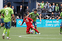 SEATTLE, WA - NOVEMBER 10: Alejandro Pozuelo #10 of Toronto FC is fouled by Nicolas Lodeiro #10 of the Seattle Sounders FC during a game between Toronto FC and Seattle Sounders FC at CenturyLink Field on November 10, 2019 in Seattle, Washington.