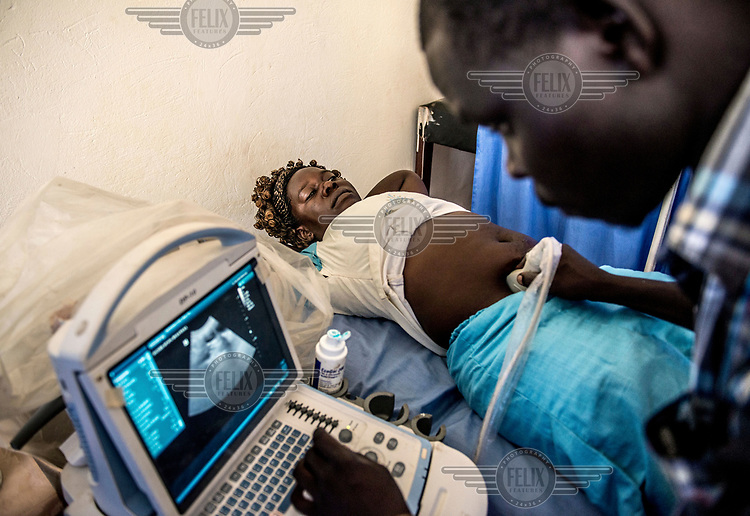 25 year old Lanyero Dorcas undergoes an ultrasound scan to try and diagnose the causes of her abdominal pain during a visit to the RHU (Reproductive Health Uganda) clinic.