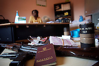 "Lucinda Gomes Barbosa Ahkharie, general director of the Guinea Bissau ""Policia Judiciaria"" in charge of prosecuting drug crimes in the country,  sits in her office while showing seized Explosives, guns, colombian IDs and almost 100.000 euros in cash  in Bissau, Guinea Bissau on Saturday Sept 15 2007.///..Guinea Bissau is infamous for its cocaine trafficking. in 2005 Colombian cartels begun to arrive in the country transforming it into a Narco State. Up to 5 tons of pure cocaine are estimated to be arriving in the country every week. Guinea Bissau is the 5th poorest country in the world, making it the ideal transit base for the cocaine that will finish on the european markets. Corruption and involvement in the trafficking are present at every level of its institutions..Guinea Bissau is only one of the countries in West Africa involved in cocaine trafficking. Tons of Cocaine have been seized in Nigeria, Senegal, Ghana and  Sierra Leone."