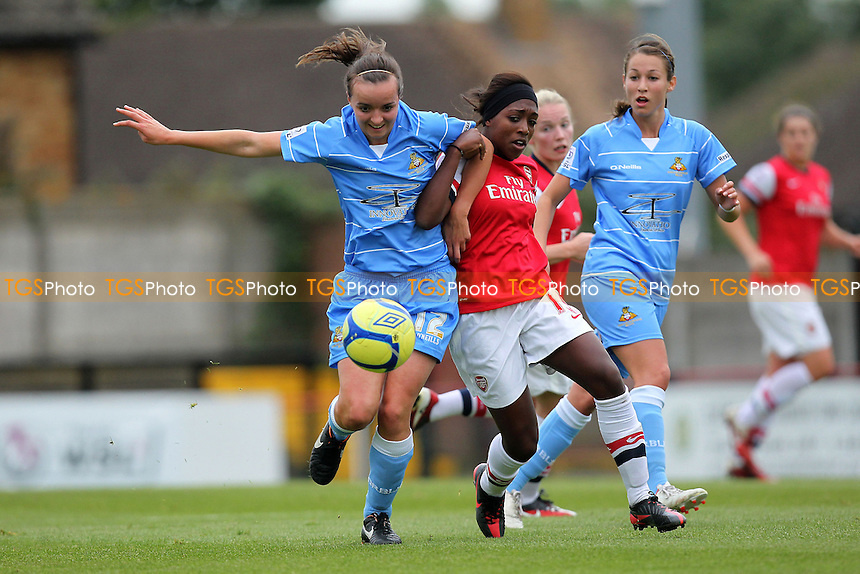 Danielle Carter of Arsenal tussles with Kasia Lipka of Doncaster - Arsenal Ladies vs Doncaster Rovers Belles - FA Womens Super League Football at Boreham Wood FC - 30/09/12 - MANDATORY CREDIT: Gavin Ellis/TGSPHOTO - Self billing applies where appropriate - 0845 094 6026 - contact@tgsphoto.co.uk - NO UNPAID USE.