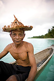 INDONESIA, Mentawai Islands, Kandui Resort, fisherman Gesayas Ges in his dugout canoe