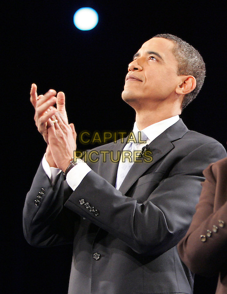 BARACK HUSSEIN OBAMA.Is sworn in as the 44th U.S. President in Washington DC., USA..January 20,2009 -.Archive photo from The CNN, LA Times, POLITICO Democratic Presidential Debate held at The Kodak Theatre in Hollywood, California on January 31,2008      .half length black suit jacket side view profile hands clapping                                                               .CAP/DVS.©Debbie VanStory/Capital Pictures.