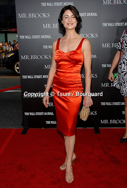 Traci Dinwiddie  arriving at Mr BROOKS Premiere at the Chinese  Theatre In Los Angeles. <br /> <br /> full length<br /> eye contact<br /> red dress<br /> smile