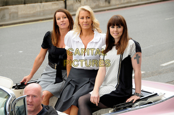 KEREN WOODWARD, SARA DALLIN & MELANIE CHISHOLM.The PINKTOBER Concert launch, Hard Rock Cafe, Piccadilly, London, England..September 7th, 2009.mel c karen sarah full length pink grey gray cadillac car sitting black white dress shirt.CAP/CAS.©Bob Cass/Capital Pictures.