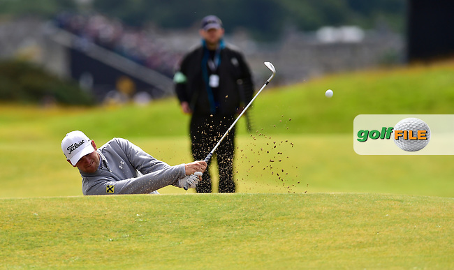 Bernd WIESBERGER (AUT) plays his 2nd shot on the 5th hole from a fairway bunker during Friday's Round 2 of the 144th Open Championship, St Andrews Old Course, St Andrews, Fife, Scotland. 17/07/2015.<br /> Picture Eoin Clarke, www.golffile.ie