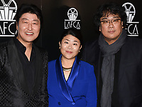 11 January 2020 - Century City, California - (L-R) Song Kang Ho, Lee Jeong-eun and Bong Joon Ho. 45th Annual Los Angeles Critics Association (LAFCA) Awards Ceremony at the InterContinental. Photo Credit: Billy Bennight/AdMedia