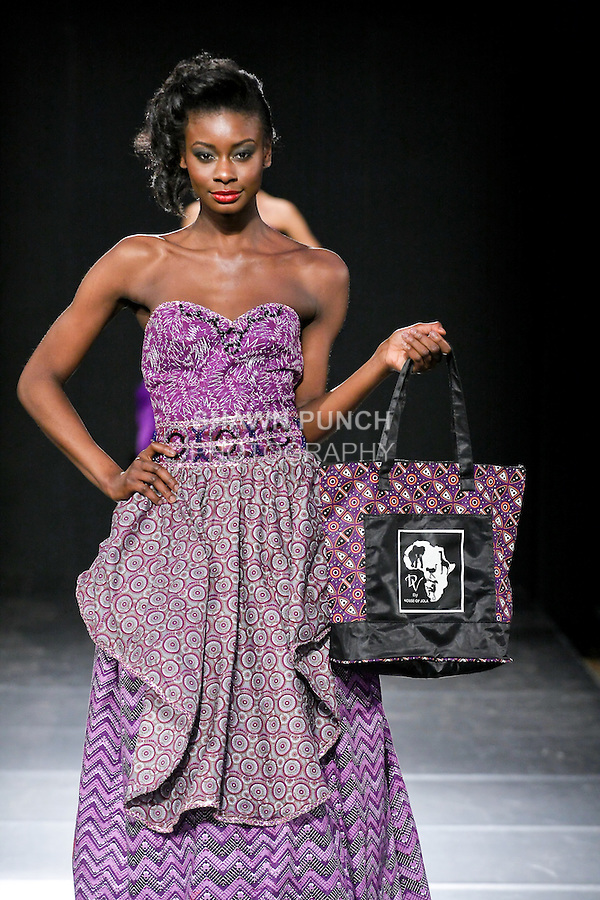Models walk runway in a House Of Jola outfit by Joan Okorodudu, during Couture Fashion Week Fall 2011 in New York.