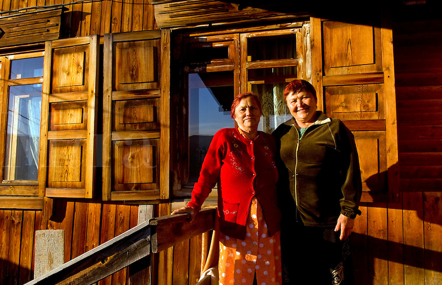 Women and wooden house, Listvyanka, near  Irkutsk, Siberia, Russia