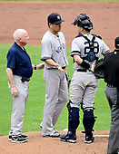 New York Yankees starting pitcher Masahiro Tanaka (19) shows his throwing hand to catcher Austin Romine (28) and head trainer Steve Donohue, left, that was slightly injured while fielding a ground ball in the second inning against the Baltimore Orioles at Oriole Park at Camden Yards in Baltimore, MD on Thursday, May 23, 2019.  Tanaka remained in the game.<br /> Credit: Ron Sachs / CNP<br /> (RESTRICTION: NO New York or New Jersey Newspapers or newspapers within a 75 mile radius of New York City)