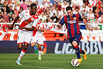 Rayo Vallecano´s Abdoulaye (L) and Barcelona´s Leo Messi during La Liga match between Rayo Vallecano and Barcelona at Vallecas stadium in Madrid, Spain. October 04, 2014. (ALTERPHOTOS/Victor Blanco)