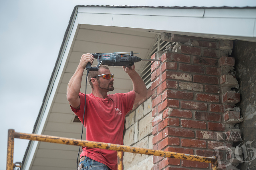 NWA Democrat-Gazette/ANTHONY REYES @NWATONYR<br /> Cecil Button, with Josh Hurtt Construction, tear down a brick wall Monday, April 17, 2017 at the Downtown Church of Christ in Rogers. The church will expand and the company will demolish the wall, pour the added foundation and rebuild the new brick walls when completed.