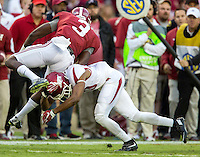 NWA Democrat-Gazette/JASON IVESTER <br /> Arkansas defensive back Jared Collins (29) tackles Alabama wide receiver Calvin Ridley (3) during the first quarter on Saturday, Oct. 10, 2015, at Bryant-Denny Stadium in Tuscaloosa, Ala.
