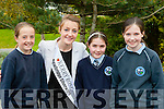 The new Kerry Rose Julet Culloty Kilcummin NS pupils Katelyn O'#Riordan, Julianna friel and Ella Kehoe on Thursday when she helped raise their Young Entreprenuer flag