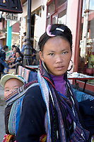 Sapa North Vietnam Black Hmong tribe street vendor sales woman with child.