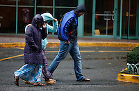 People walks against the wind as Hurricane Sandy begins to affect the area in Newport New Jersey United States. 29/10/2012. Photo by Kena Betancur/VIEWpress.