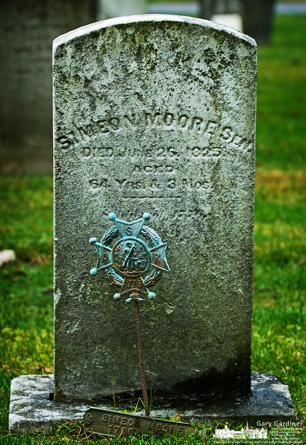 A revolutionary War soldier's marker sits next to his grave in Pioneer Cemetery in Westerville, Ohio.<br />