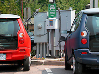 ALTERNATIVE ENERGY<br /> Electric Cars Plugged Into Charging Station<br /> An experimental program in Chappaqua NY, allows commuters to lease electric cars which are guaranteed a parking spot in the municipal parking lot where the cars can be recharged.