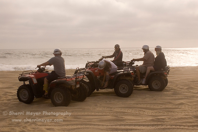 Group of tourists riding Quads on the playa near Migrino, Baja California, Mexico