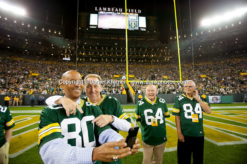 Former Green Bay Packer receiver James Lofton and quarterback Don Majkowski take a selfie at Lambeau Field during alumni introductions prior to the kickoff betwen the Seattle Seahawks and the Packers on Sept. 20, 2015.
