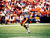 Washington Redskins quarterback Jay Schroeder (10) carries the ball in early first quarter action against the Philadelphia Eagles at RFK Stadium in Washington, DC  on September 13, 1987.  The Redskins won the game 34 - 24.<br /> Credit: Ron Sachs / CNP