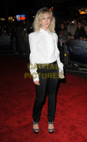 "JUNO TEMPLE .attending The Times BFI 53rd London Film Festival Premiere of ""Cracks"" at Vue West End, Leicester Square, London, England, UK, .25th October 2009.full length white shirt shoulder pads puffy shoulders black trousers peep toe shoes belt clutch bag .CAP/BEL.©Tom Belcher/Capital Pictures"