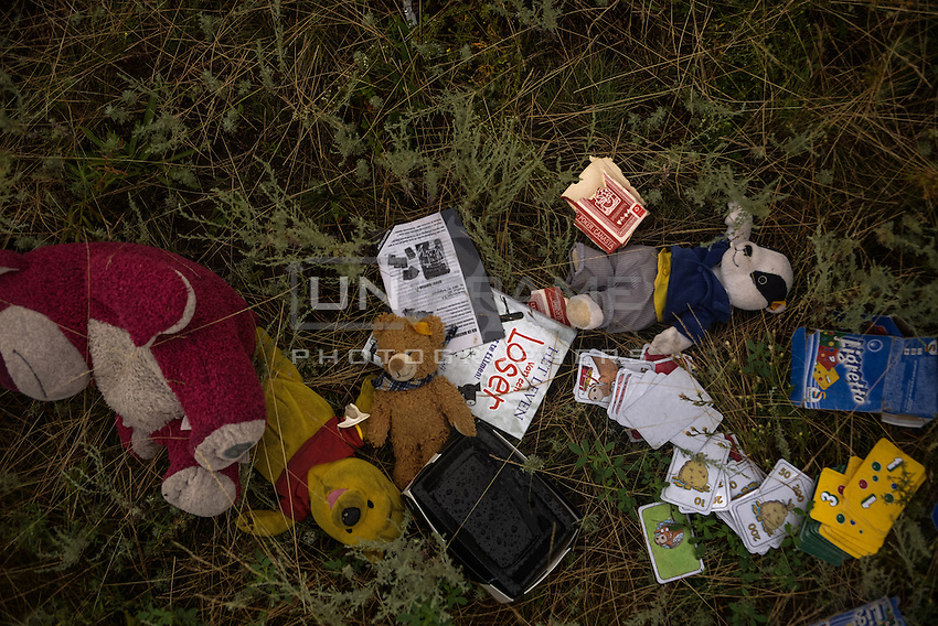 Belongings of 289 passengers on Malaysia MH17 crash site, scattered across fields covering an area of 20 sq km. Near Hrabove, Donetsk Oblast, Ukraine. Jul. 18, 2014