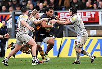High Wycombe, England.  Billy Vunipola of London Wasps  tackled during the Aviva Premiership match between London Wasps and Sale Sharks at Adams Park on December 23. 2012 in High Wycombe, England.