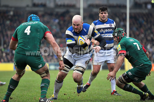 Matt Garvey of Bath Rugby takes on the Leicester Tigers defence. Aviva Premiership match, between Leicester Tigers and Bath Rugby on January 4, 2015 at Welford Road in Leicester, England. Photo by: Patrick Khachfe / Onside Images