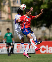 Gilbeto Pena (2) of El Salvador goes up for a header against Ronald Matarrita (16) of Costa Rica during the group stage of the CONCACAF Men's Under 17 Championship at Jarrett Park in Montego Bay, Jamaica. Costa Rica defeated El Salvador, 3-2.