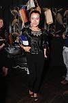 during the Laura Vela handbag installation at No. 8 in New York City on September 17, 2013.