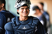 Catcher Ricardo Ferriera (19) of the Charleston RiverDogs in a game against the Greenville Drive on Friday, April 27, 2018, at Fluor Field at the West End in Greenville, South Carolina. Greenville won, 5-4. (Tom Priddy/Four Seam Images)