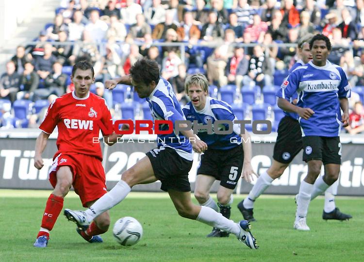 1.Liga FBL 2008/2009  5. Spieltag Hinrunde<br /> Arminia Bielefeld - vs. 1.FC Koeln<br /> <br /> Sergiu Radu (Nr.24) links, gegen Markus Schuler (Nr.2)<br /> <br /> <br /> <br /> Foto &copy; nph (nordphoto)<br /> <br /> *** Local Caption ***