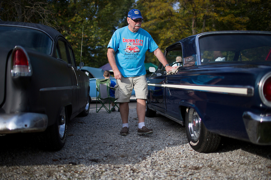 Bob Kaufman cleans his car during the Ducktail Run Rod & Custom Show in Gas City, Ind., on Saturday, Sept. 29, 2014. (Photo by James Brosher)