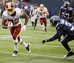 Washington Redskins wide receiver Fred Davis, left, is brought down by Seattle Seahawks cornerback Kam Chancellor in the first quarter at  CenturyLink Field in Seattle, Washington on November 27, 2011. Davis caught a 20-yard pass from quarterback Rex Grossman that set up the Redskins 1st touchdown, which was also scored by Davis.  Redskins stunned the Seattle Seahawks 23-17.  ©2011 Jim Bryant Photo. All Rights Reserved.