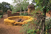 A simple fire circle made of straw bales dominates the yard, while thick plastered walls anchor the santuraio into the  earth.
