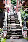 The stairs entering the Bramavihara-Arama Buddhist Temple, on the north side of Bali, are marked with reminders of the Buddha's teaching on the stages of enlightenment.