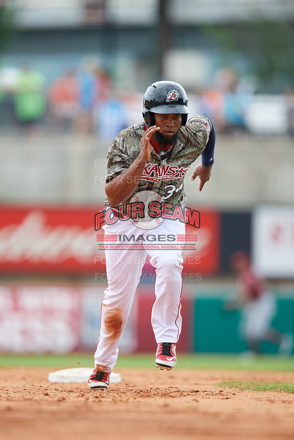 Arkansas Travelers right fielder Keury De La Cruz (34) runs to third base during a game against the Frisco RoughRiders on May 28, 2017 at Dickey-Stephens Park in Little Rock, Arkansas.  Arkansas defeated Frisco 17-3.  (Mike Janes/Four Seam Images)