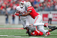 Ohio State Buckeyes linebacker Raekwon McMillan (5) slams into Indiana Hoosiers wide receiver Shane Wynn (1) as Ohio State Buckeyes defensive back Vonn Bell (11) tangles him up in the first quarter of the college football game between the Ohio State Buckeyes and the Indiana Hoosiers at Ohio Stadium in Columbus, Saturday afternoon, November 22, 2014. The Ohio State Buckeyes defeated the Indiana Hoosiers 42 - 27. (The Columbus Dispatch / Eamon Queeney)