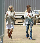 May 22nd 2010    Exclusive ...Pamela Anderson watching her kids play baseball with her new boyfriend at a park in Malibu California. Pamela's new man was wearing a hot pink t-shirt with matching shoes. They were very touchy feely as they watched the game & he even gave her  a kiss goodbye as he helped her into car. Pamela was very hungry & ate a bagel pretzel & a hotdog while holding a baby on the bleachers.  Pamela was walking around with no shoes on dressed like a homeless bag lady...AbilityFilms@yahoo.com.805-427-3519.www.AbilityFilms.com