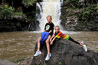 Two sisters (11 years old, 8 years old) at Waimea Falls, Waimea Valley, Oahu, Hawaii