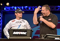 NWA Democrat-Gazette/BEN GOFF -- 04/25/15 Stetson Blaylock, FLW pro from Benton, weighs-in with master of ceremonies Chris Jones on day three of the Walmart FLW Tour at Beaver Lake on Saturday Apr. 25, 2015 at the John Q. Hammons Center in Rogers. Blaylock stood in third place with a three-day total of 37 lbs. 3 oz.