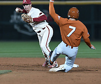NWA Democrat-Gazette/J.T. WAMPLER  Arkansas' Jax Biggers makes the throw to first for a double play after catching Texas' Masen Hibbeler at second Tuesday March 13, 2018 at Baum Stadium in Fayetteville. The Razorbacks beat the Longhorns 13-4.