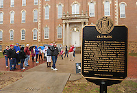 NWA Media/ANDY SHUPE - Visitors, parents and prospective students participate in a tour of the University of Arkansas campus near Old Main and the Senior Walk Monday, Dec. 22, 2014, on the university campus in Fayetteville.