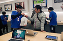 March 16, 2012, Tokyo, Japan - Staff of the Ginza Apple store gives the customer the new tablet wrapped in a bag with the logo of Apple. .Fans lined up overnight outside the Apple store in Ginza, to buy the new iPad. Japan was one of the first countries where Apple fans could get their hands on the new iPad.