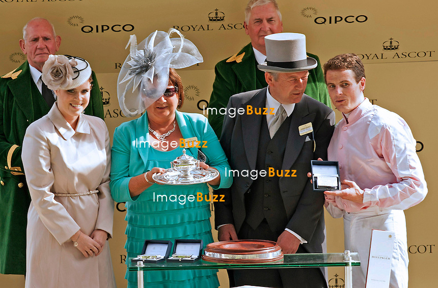PRINCESSES BEATRICE AND EUGENIE WITH PRINCE HARRY<br /> The Queen, Duke of Edinburgh ; Prince Charles, Camilla, Princes Andrew and Harry Prince Harry, Princesses Eugenie and Beatrice, Sophie, Countess of Wessex and the Michaels of Kent were in attendance on the opening day of the 4-day Royal Ascot Race Meeting.<br /> United Kingdom, Ascot, June 18, 2014.