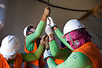 CAETITE, BRAZIL - OCTOBER 25, 2013:<br /> Workers hoist tools up a new tower in a Renova Energia wind-turbine park, in the municipal of Caetite, in Bahia state, Brazil, on Friday, Oct 25, 2013. <br /> (Photo by Lianne Milton/For The Washington Post